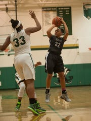 Timber Creek senior guard Brittany Martin shoots over Camden Catholic's Brittany Garner (left) during the first quarter of a game at Camden Catholic earlier this season.
