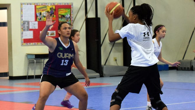 The Guam Basketball Confederation held U18 girls' basketball tryouts at the Bishop Baumgartner Memorial School gym in Sinajana on Jan. 31. Meaghan Cruz (left) and Britney Bailey will play a big role in the team's future.