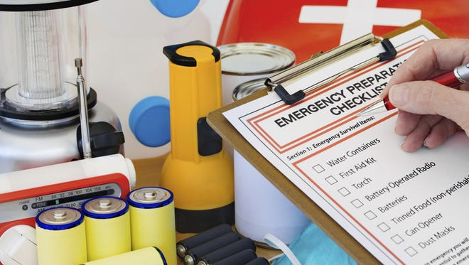 Stock photo: Hand completing Emergency Preparation List by Equipment