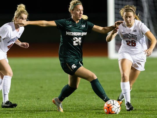 Former MSU player Kirsten Evans of Farmington Hills controls the ball in the midfield during a Big Ten game with Ohio State.