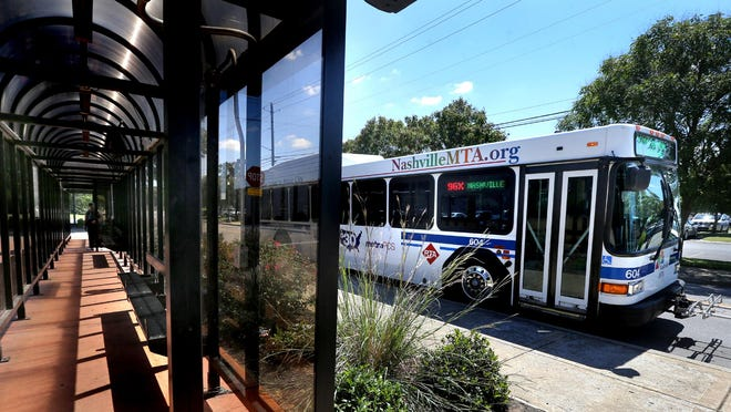 An MTA bus stops at the corner of Burton and Walnut to pick up passengers traveling to Nashville, Smyrna and La Vergne, on Wednesday, Aug. 26, 2015.