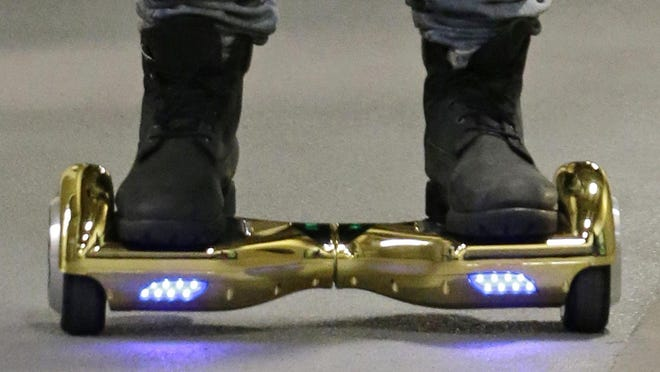 Several Indiana universities have banned or limited hoverboards on their campuses, saying the two-wheeled, motorized scooters are unsafe.