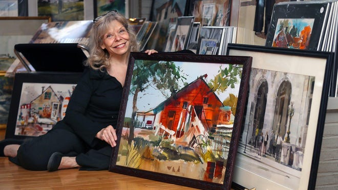 Beth Becker's Bath living room is filled with more than 160 paintings as she prepares the artworks for the Hal Scroggy Retrospective Show at Peninsula Art Academy on Saturday.