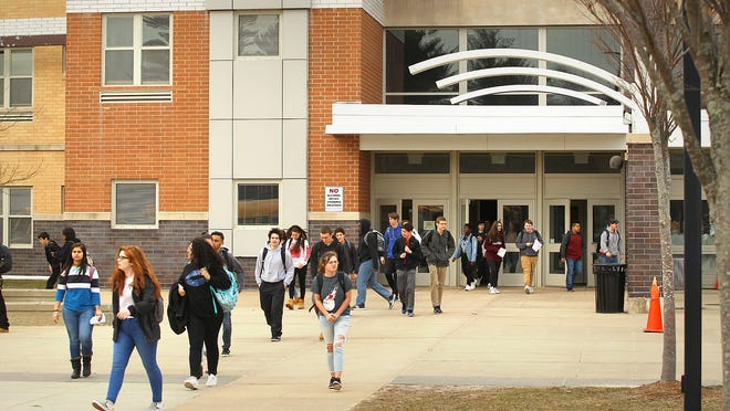 Students exit Weymouth High School at dismissal time in 2018.