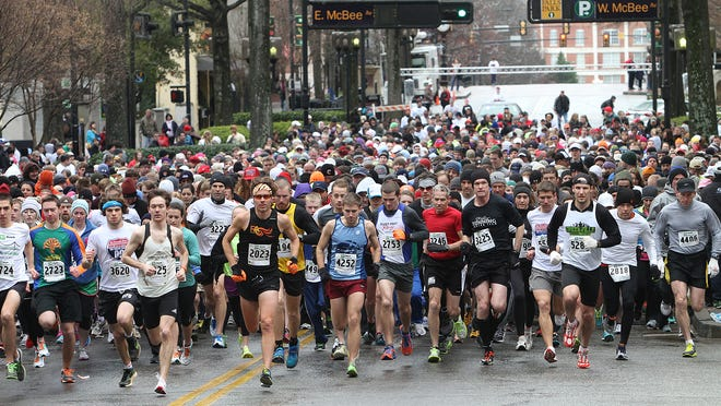 In this 2013 file photo, runners take off during the start of the Reedy River Run. Tyler Scott, the race director for the Reedy River Run, estimated that 2,000 runners have registered for this year's event, including 22 elite racers from across the Southeast region.