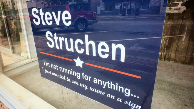 Steve Struchen of Webster City, Ia., is an undecided voter in this year's zany presidential election, but that didn't stop him from posting an amusing campaign sign in the shopfront window of his downtown appliance store.