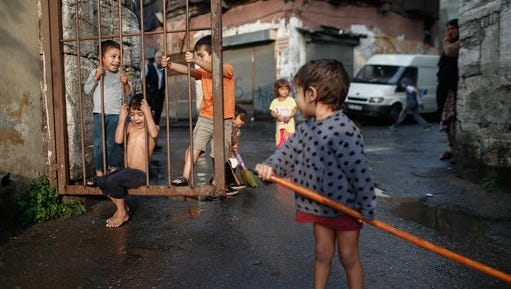 On Oct. 6, Syrian children play on a street in Istanbul, part of a mass migration of refugees through Turkey.