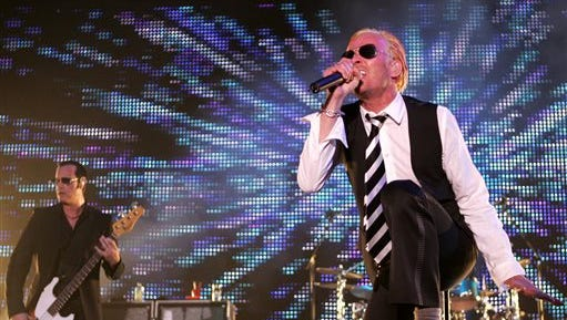 In this May 17, 2008, file photo, Scott Weiland, singer for the rock band Stone Temple Pilots, right, and bass player Robert DeLeo perform during their concert as part of Rock on the Range in Columbus, Ohio. Weiland, the former frontman for the Stone Temple Pilots and Velvet Revolver, has died. He was 48. The singer's manager confirmed the death to The Associated Press early Friday.