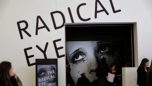 "A large promotional poster of Man Ray's ""Glass Tears"" stands in the entrance at the press view of ""The Radical Eye: Modernist Photography from the Sir Elton John Collection"" exhibition at the Tate Modern gallery in London, Tuesday, Nov. 8, 2016. British musician Elton John's collection of international modernist photography from the 1920s to 50s includes almost 200 prints and opens to the public on November 10."