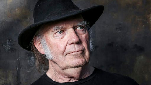 "FILE - In this May 18, 2016, file photo, Neil Young poses for a portrait in Calabasas, Calif., to promote his new album, ""Earth."" Young penned an open letter on Facebook posted on Monday, Nov. 28, 2016, in which he calls for President Barack Obama ""to step in and end"" what he calls the ""violence"" against protesters demonstrating against an oil pipeline being built on part of an Indian reservation in North Dakota."