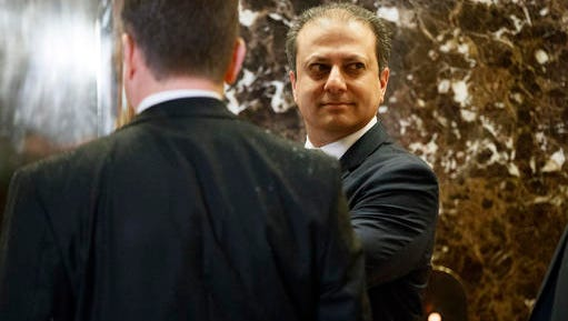 U.S. Attorney for the Southern District of New York, Preet Bharara, waits for the elevator in the lobby of Trump Tower, Wednesday, Nov. 30, 2016, in New York.
