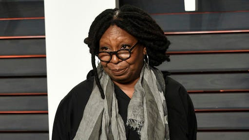 FILe - This Feb. 28, 2016 file photo shows Whoopi Goldberg at the Vanity Fair Oscar Party in Beverly Hills, Calif.  Goldberg is being targeted by a North Carolina county commissioner over her comments about President-elect Donald Trump. Local media reports New Hanover County Commission Chairman Woody White used Facebook to criticize Cape Fear Community College for hosting Goldberg's concert June 23. (Photo by Evan Agostini/Invision/AP, File)