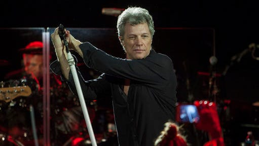 FILE - This Dec. 3, 2016 file photo shows Jon Bon Jovi performing with his band during Art Basel in Miami Beach, Fla. The band is holding a contest to choose bands or singers to open for their upcoming tour. Artists will upload videos of themselves performing original music, and concert promoters Live Nation will select 10 finalists. Bon Jovi management will then pick winners from the finalists to perform 20-minute sets. (Photo by Jesus Aranguren/Invision/AP, File)