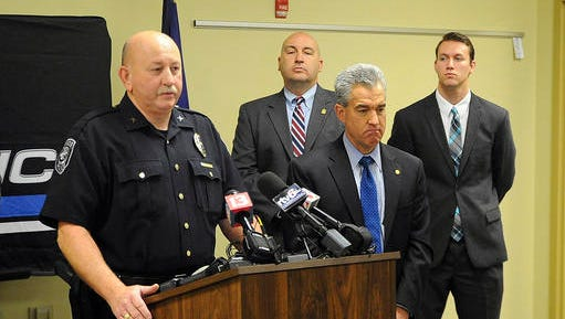 Seymour Police Chief Bill Abbott speaks at a press conference on Friday, Jan. 13, 2017,  next to U.S. Attorney Josh Minkler announcing the arrest of Charles Hollin.  Federal authorities say Hollin, charged in the 1999 abduction and sexual assault of a southern Indiana girl, assumed the identity of a car crash victim and lived for years in Minnesota and Oregon until he was arrested this week. Investigators tracked down 61-year-old Charles Hollin to Salem, Oregon, after he was identified through facial recognition software of his passport photograph, Minkler said Friday at a news conference. (Aaron Piper/The Tribune via AP)