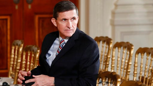 FILE - In this Feb. 10, 2017 file photo, then-National Security Adviser Michael Flynn sits in the East Room of the White House in Washington. Documents released in a congressional inquiry show Flynn was paid more than $33,750 by RT, Russia's government-run television system, for appearing at a Moscow event in December 2015. Flynn had retired months earlier as head of the U.S. Defense Intelligence Agency.