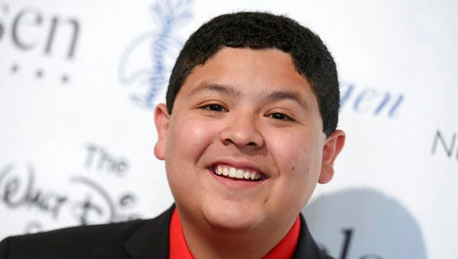 "FILE - In this Aug. 21, 2015, file photo, Rico Rodriguez arrives at the 30th annual Imagen Awards at the Dorothy Chandler Pavilion in Los Angeles. The actor who plays Manny on the popular sitcom ""Modern Family"" said on social media Sunday, March 19, 2017, that he is mourning the death of his father, Roy Rodriguez."