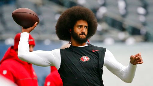 """FILE - In this Dec. 4, 2016, file photo, San Francisco 49ers quarterback Colin Kaepernick warms up before an NFL football game against the Chicago Bears. Spike Lee said on Instagram Sunday, March 19, 2017, that it was """"fishy"""" that Kaepernick, now a free agent, hadn't been signed."""""""