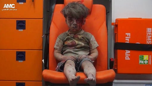 FILE --In this Aug. 17, 2016 file frame grab taken from video provided by the Syrian anti-government activist group Aleppo Media Center (AMC), 5-year-old Omran Daqneesh sits in an ambulance after being pulled out of a building hit by an airstrike in Aleppo, Syria. With its missile strike on Shayrat Airbase in central Syria, Washington signaled that it had judged President Bashar Assad responsible for the horrific chemical weapons attack in north Syria that drew international outrage last week. But it is not the first or even deadliest atrocity of the war.