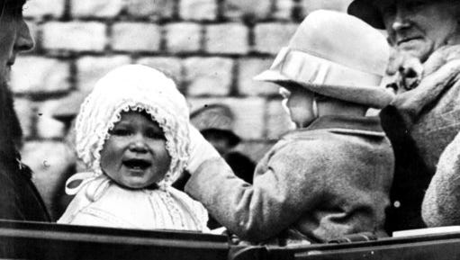 In this 1927 file photo, Princess Elizabeth is taken for a ride in the grounds of Windsor Castle, with her cousin, the honourable Gerald Lascelles, right, son of Princess Royal. Britain's Queen Elizabeth celebrates her 91st birthday on Friday, April 21, 2017.