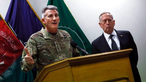 U.S. Defense Secretary James Mattis , right, and U.S. Army General John Nicholson, left, commander of U.S. Forces Afghanistan, hold a news conference at Resolute Support headquarters in Kabul, Afghanistan, Monday, April 24, 2017. Mattis arrived unannounced in Afghanistan to assess America's longest war as the Trump administration weighs sending more U.S. troops.
