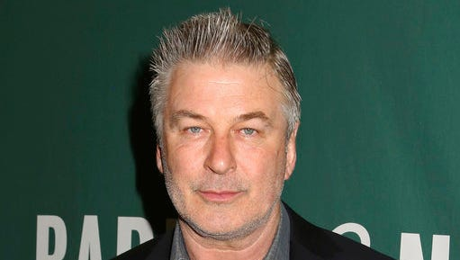 """FILE- In this April 4, 2017, file photo, actor Alec Baldwin appears at Barnes & Noble Union Square to sign copies of his new book, """"Nevertheless: A Memoir"""" in New York. Baldwin, who has won acclaim for his portrayal of President Donald Trump on """"Saturday Night Live,"""" will be headlining a New Jersey political fundraiser. General Majority PAC says in an invitation that the actor will appear next month at the $2,500-a-head event in Collingswood, N.J."""