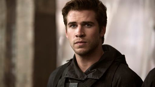 """In this image released by Lionsgate, Liam Hemsworth portrays Gale Hawthorne in a scene from """"The Hunger Games: Mockingjay Part 1."""" (AP Photo/Lionsgate, Murray Close)"""