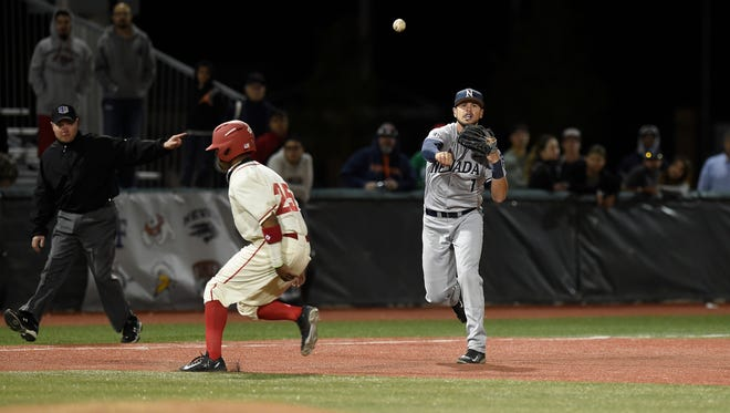 Bryce Greager throws across the diamond during Nevada's MW Tournament game against New Mexico on Thursday.