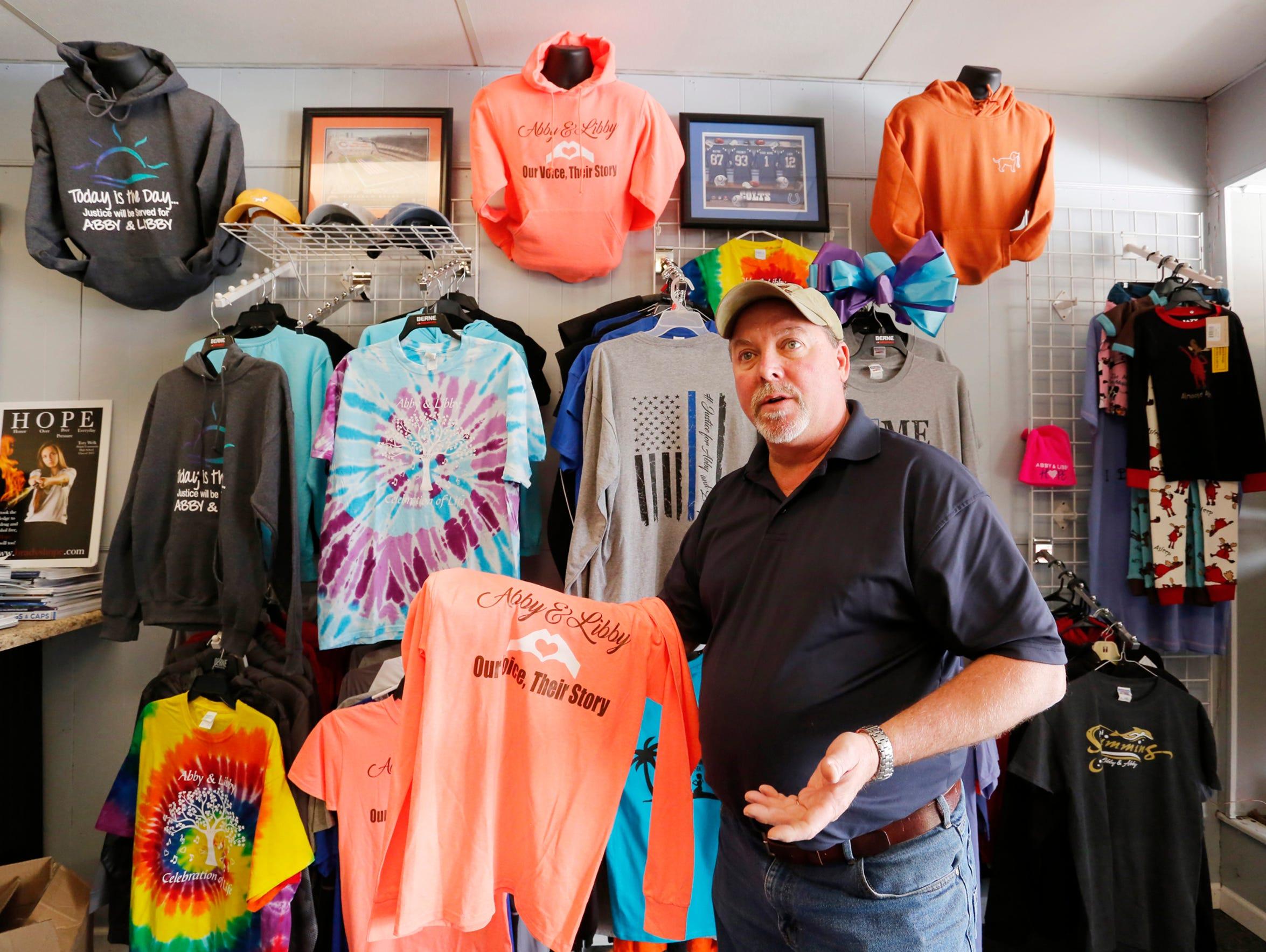 Mark Mendel shows shirt designs in honor of Liberty
