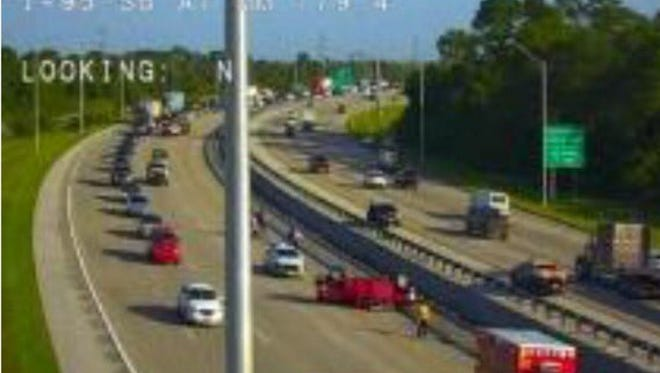 A traffic camera on I-95 southbound in West Melbourne shows a crash with injuries that caused serious delays Wednesday morning.