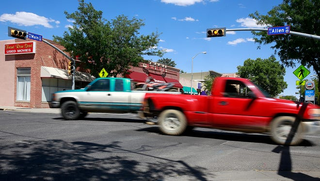 Motorists venture across Main Street at Allen Avenue on Friday in Farmington, one of three downtown intersections where the traffic lights are due to be removed.