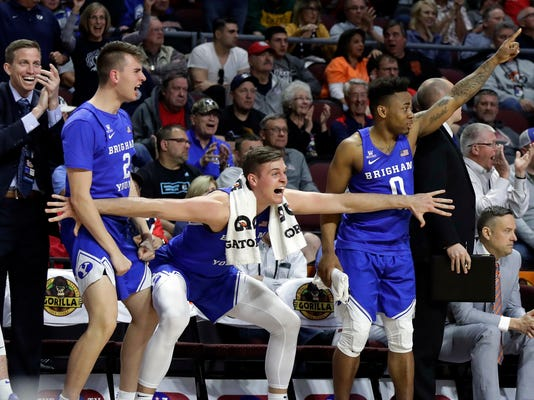 BYU's bench reacts after a dunk during the second half of a West Coast Conference tournament NCAA college basketball game against Saint Mary's, Monday, March 5, 2018, in Las Vegas. BYU defeated Saint Mary's 85-72. (AP Photo/Isaac Brekken)