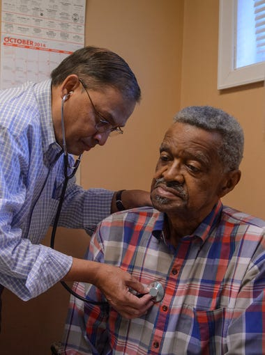 With no rural hospitals close, Philip Crayton, 79, traveled 30 miles from his home in Omaha, GA to be examined by Dr. Alluri Raju in Richland, GA.