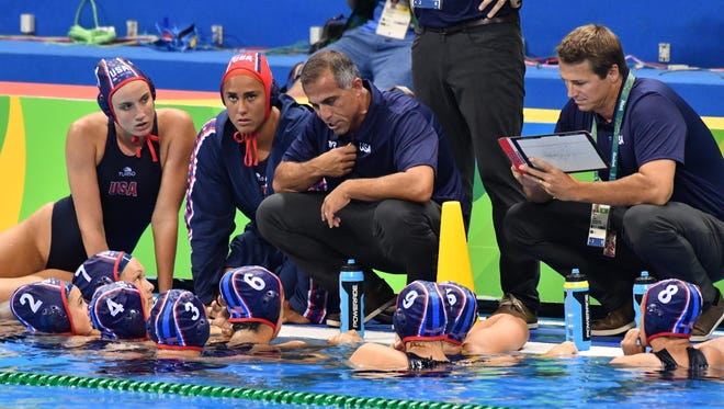 USA coach Adam Krikorian speaks to his team against Hungary during a women's water polo semifinal match in the Rio 2016 Summer Olympic Games at Olympic Aquatics Stadium on Aug. 17.