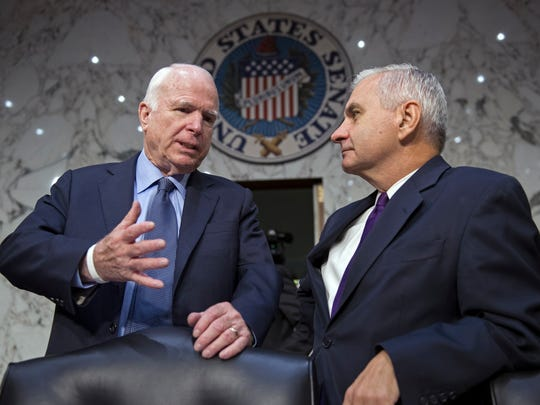 Senate Armed Services Committee Chairman Sen. John McCain, R-Ariz., left, talks with the committee's ranking member Sen. Jack Reed, D-R.I. on Capitol Hill in Washington, Thursday, Sept. 17, 2015, before the start of the committee's hearing on maritime security strategy in the Asia-Pacific region.