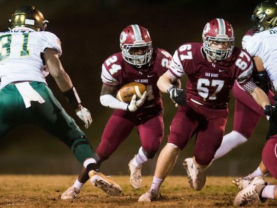 Oak Ridge's Adarius Simpson (24) runs with the ball during a TSSAA football play-off game between Knoxville Catholic and Oak Ridge at Oak Ridge Friday, Nov. 17., 2017.