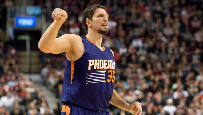 Phoenix Suns' Mirza Teletovic reacts after making a 3-point shot during the second half of an NBA basketball game against the Toronto Raptors in Toronto on Sunday, Nov. 29, 2015.