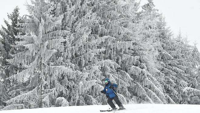 A skier enjoys opening day at Snow Trails,  3100 Possum Run Road, Mansfield, on Friday morning.