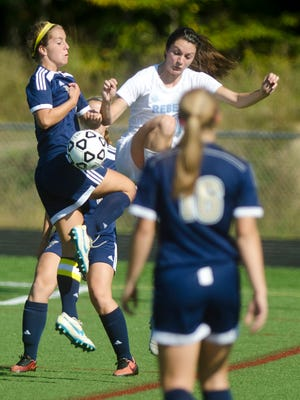 Essex defender Olivia Malle, left, leaps to win a throw in away from South Burlington's Kayla Gilding, right, during Saturday's girls soccer game in South Burlington.