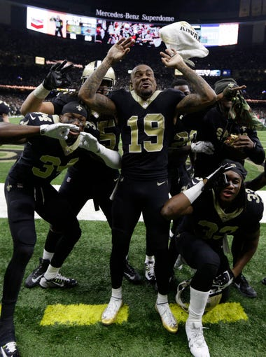 New Orleans Saints wide receiver Ted Ginn (19) and teammates react after defeating the Carolina Panthers in the wild-card playoff game at Mercedes-Benz Superdome.