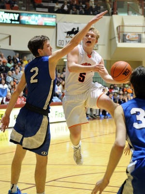 Burkburnett senior Case Caldwell (5) committed to play basketball at Midwestern State University on Monday.