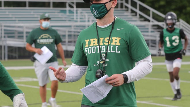 St. Vincent-St. Mary  coach Bobby Nickel talks with his offensive players during practice earlier this month.