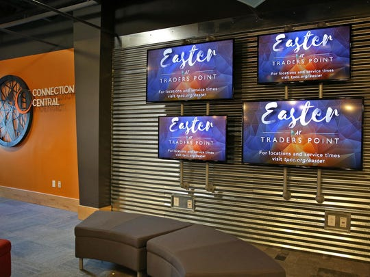 Easter service information and other items of interest are posted on screens in the Connection Central area at Traders Point Christian Church, Monday, March 21, 2016.