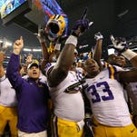 LSU Tigers head coach Les Miles celebrates a 37-27 win with his team against Texas Christian Horned Frogs in the season opener for both teams on Saturday night.