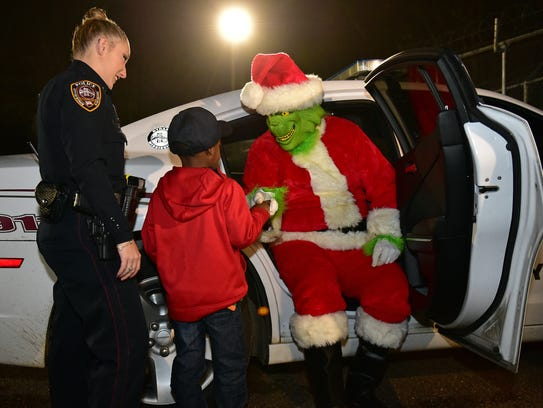 "TyLon Pittman, 5, ""arrests"" the Grinch for attempting"