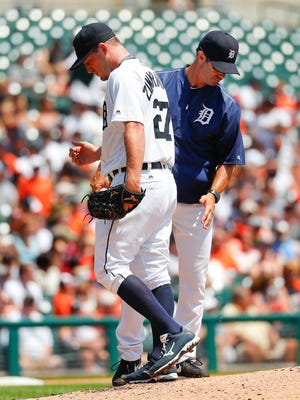 Detroit Tigers pitcher Jordan Zimmermann, left, is relieved by manager Brad Ausmus in the second inning against the Chicago White Sox on Thursday, Aug. 4, 2016, in Detroit.