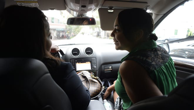 Chantelle Cade, 18, of Orlando, gets a ride on Sept. 23 from her stepmother, Yolanda, to a bus stop.