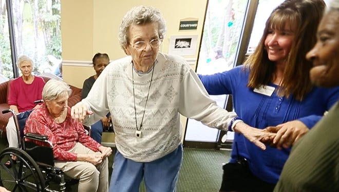 """""""Music goes into my soul and I can't sit still,"""" says Karlein Berberich, 98, of her love of dancing. A former USO dancer, Berberich lives in Hidden Oaks Assisted Living and Alzheimer's Residence in Fort Myers, Fla."""