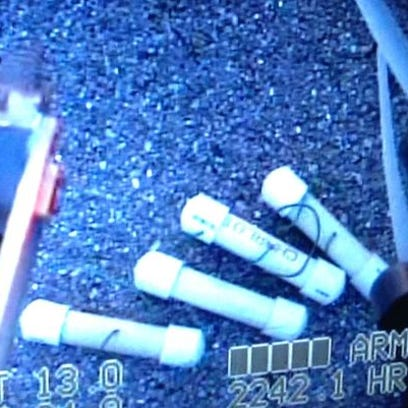 Some of the nine pipe bombs found in a golf bag at