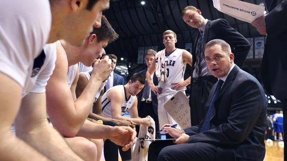 Butler University Head Coach Chris Holtmann talks to his players during a time out in the Bulldogs' 64-61 win over Creighton University at Hinkle Fieldhouse on Wednesday, Jan. 21, 2015.