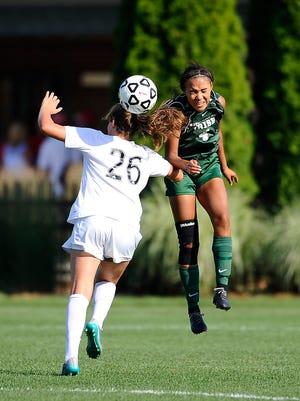 Irish defender Nadia Burbank heads a ball forward over Forest Hills Northern's Lauren Kozal.
